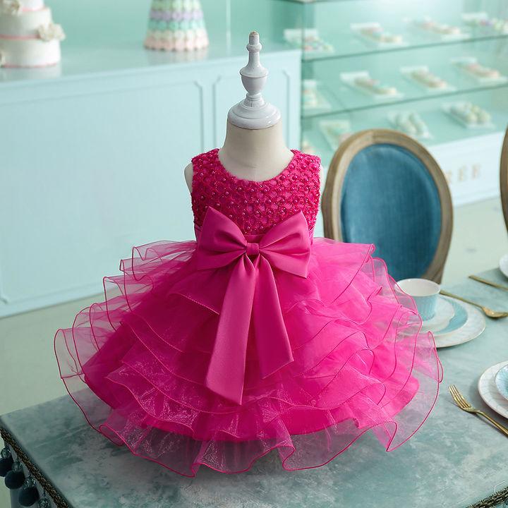 b89c5b04d473 Hopscotch - Si Rosa - Fuchsia Bow Applique Multi Layer Knee Length Dress